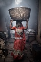 A woman from Dharavi carrying a basket on her head