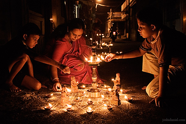 A family lighting up oil lamps during the Karthika Deepam festival in Trivandrum