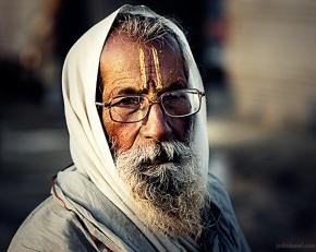 Portrait of a bearded man with spectacles from Maha Kumbh Mela in Allahabad (Prayag)
