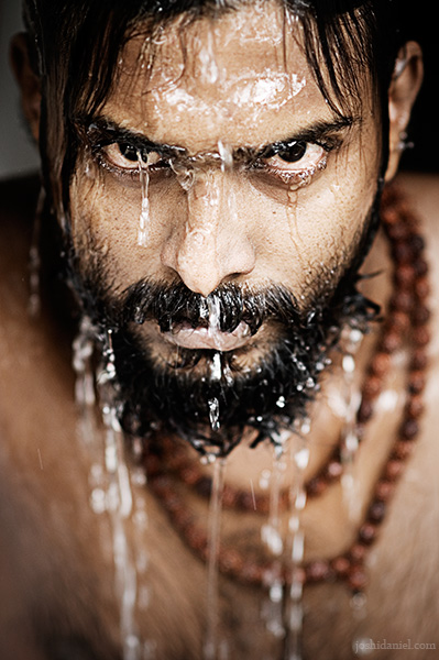 Portrait of Abilash Thankan gazing with water dripping from his face