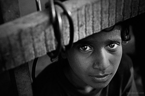 Black and white portrait of a young boy from a street in Mumbai