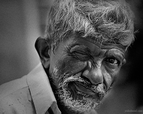 Black and white portrait of a one eyed man from Trivandrum, Kerala