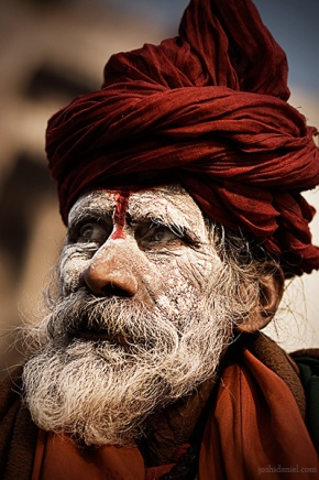 Portrait of an ash smeared sadhu in a turban from Varanasi, India