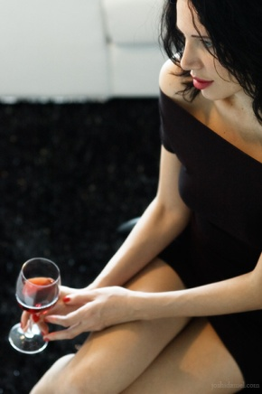 Portrait of Alexandra Pisetskaya holding a glass of red wine