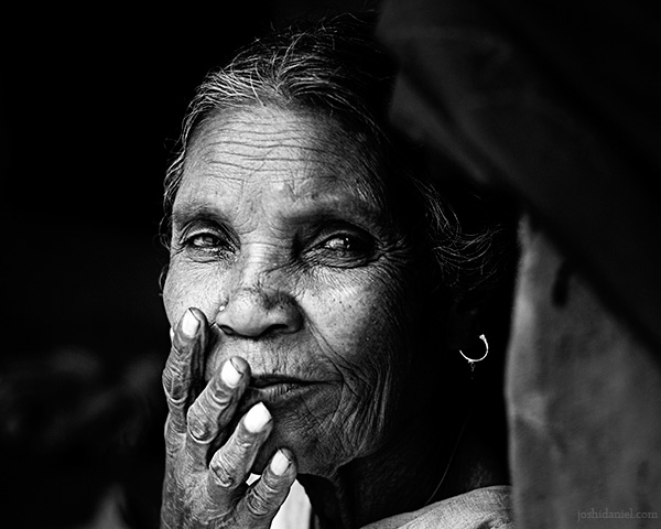 Black and white portrait of a tribal woman from Wayanad