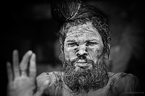 Black and white portrait of a naga sadhu from Varanasi, India