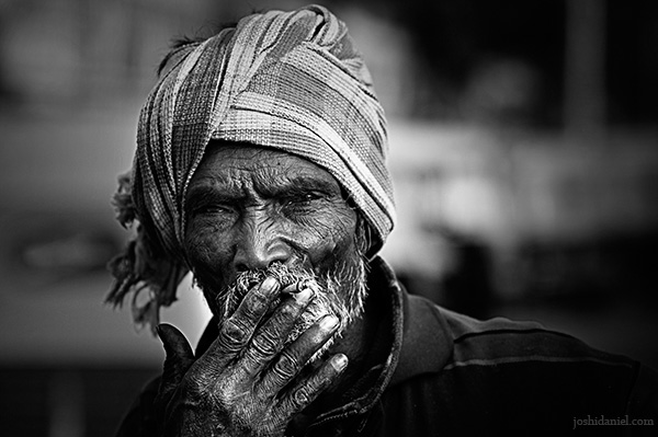 Black and white portrait of a smoking old man from Bangalore