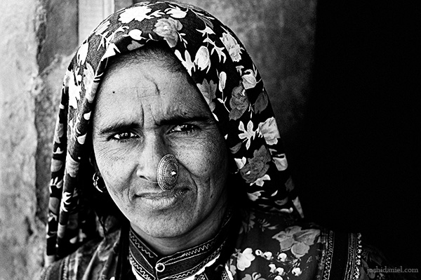 Black and white portrait of a Rajasthani woman in traditional attire from Kuldhara