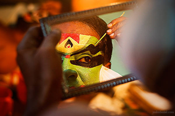 Reflection of a kathakali artist doing make-up
