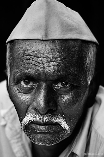 Black and white portrait of a Marathi man with topi from Pune, India