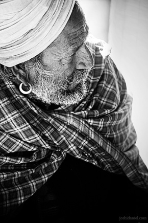 Black and white portrait of an old man in a turban from Rajasthan, India