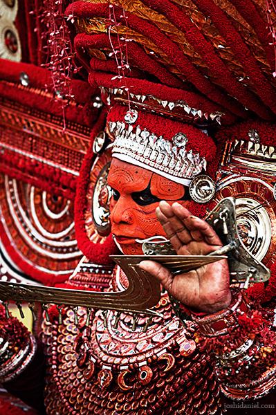 Portrait of muchilottu bhagavati theyyam performer holding a sword