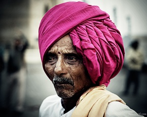 Portrait of an old man wearing a turban at Gateway of India, Mumbai