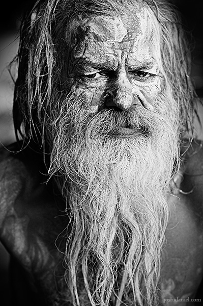Black and white portrait of a menacing naga sadhu from Varanasi, India