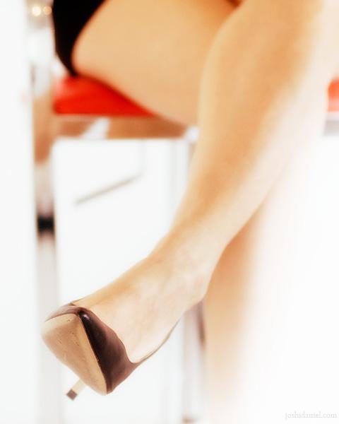 Legs of a female model wearing a black heels