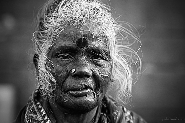 Black and white portrait of an old flower seller in Koyambedu market, Chennai