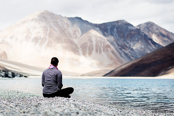 Photograph of Pauline sitting by the Pangong lake in Ladakh, Jammu and   Kashmir