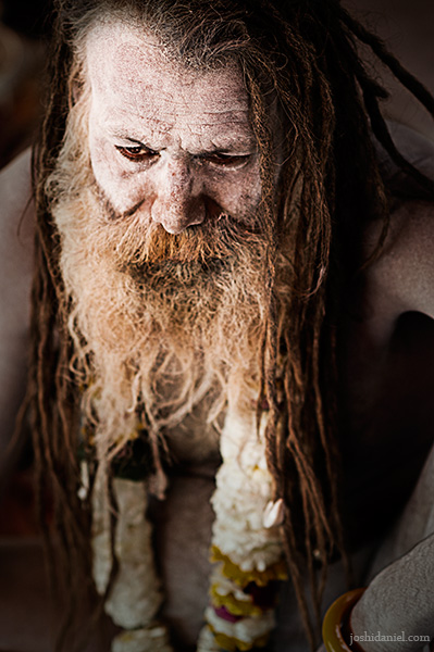 Portrait of a dark-eyed naga sadhu from Varanasi, India