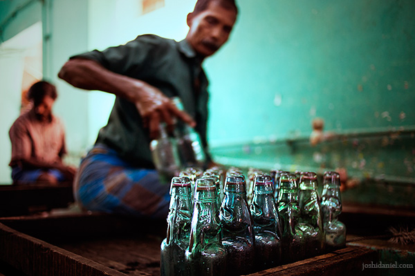 A worker cleaning Goli soda bottles at Vasu and Co., Chennai