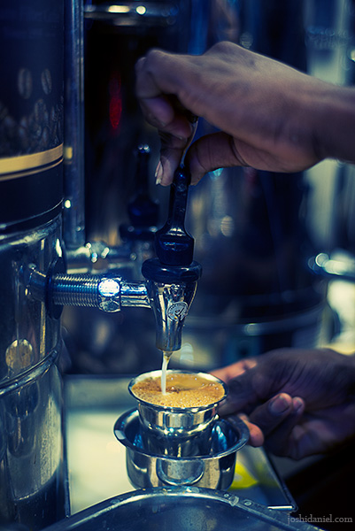 A man making filter coffee at Vivekananda Coffee in Chennai