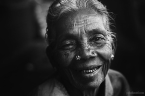 Black and white portrait of an old woman in Bangalore smiling