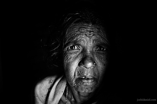 Black and white portrait of an old Kurumba tribe woman of Attappadi in Palakkad district of Kerala
