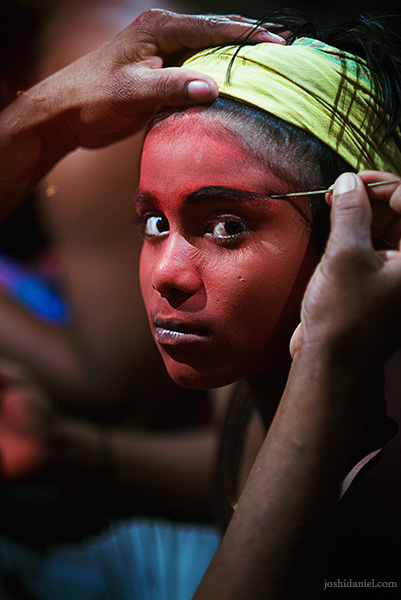 A young Kattai kooth performer during his make-up session at the Mylapore festival in Chennai