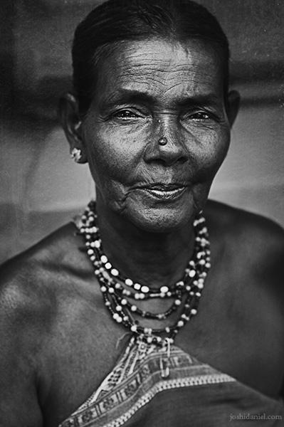 An old Halakki tribal woman in Gokarna wearing traditional jewellery