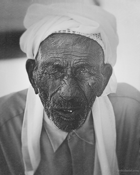 Black and white portrait of an old man in Sharjah, United Arab Emirates