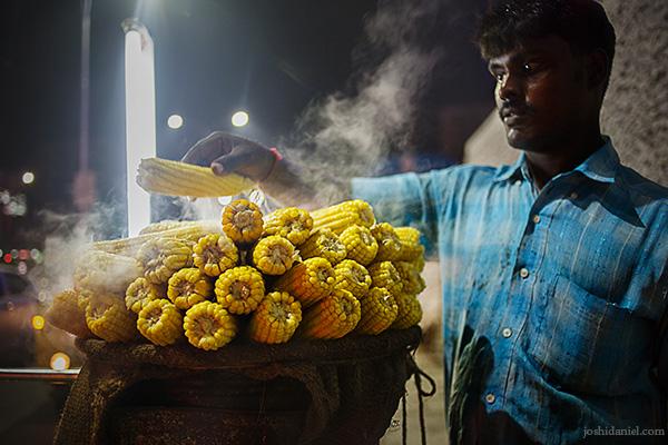 A man selling freshly steamed corn at Chennai, India