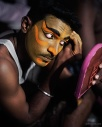 A Kattai koothu performer putting on his make-up at the Mylapore festival in Chennai