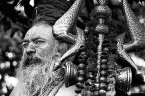 Black and white portrait of a naga sadhu with trishula at the Kumbh Mela 2010 in Haridwar