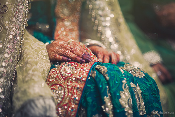 A bride's mehndi painted hands on her wedding day