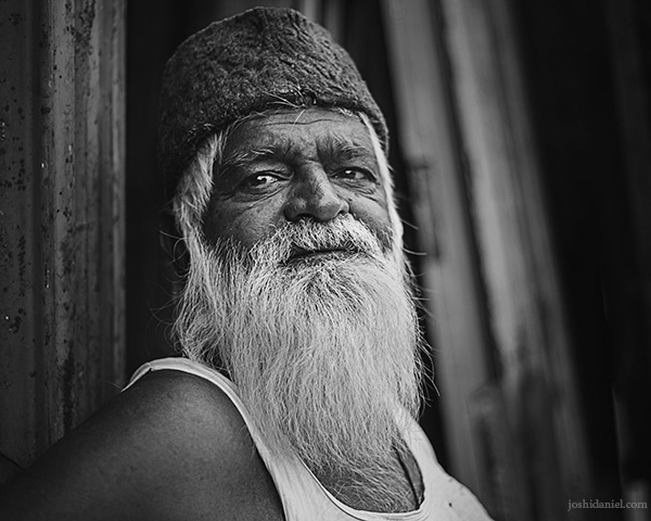 Black and white portrait of an old man trading in scrap in Madiwala, Bangalore