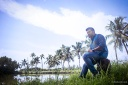 Malayalam film actor Indrajith Sukumaran sitting in a coconut grove in Ernakulam, Kerala