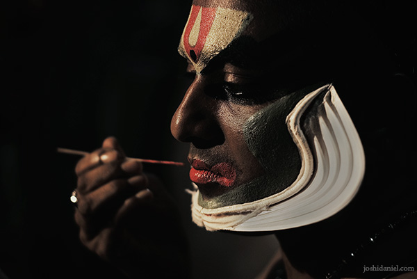 Portrait of a Kathakali artist from Trivandrum, Kerala applying make-up