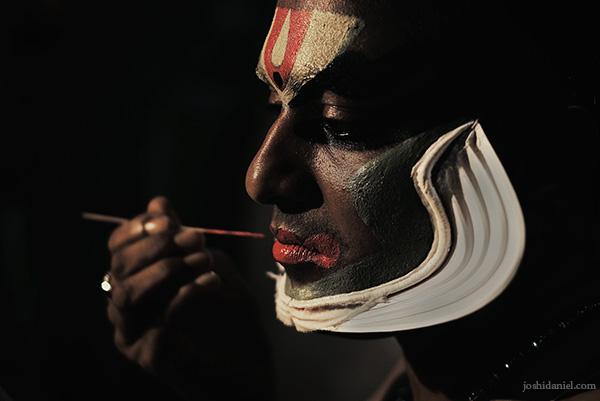 Portrait of a Kathakali artist from Trivandrum, Kerala applying make-up