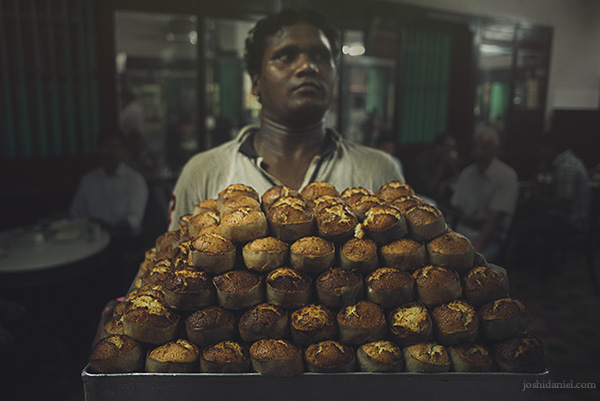 A worker at B. Merwan and Co. in Mumbai carrying a tray full of Mawa cake