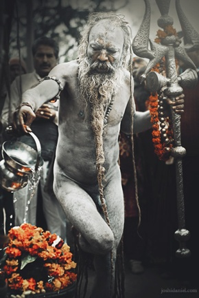 A Naga Sadhu performing a ritual in Kumbh Mela in Haridwar, India