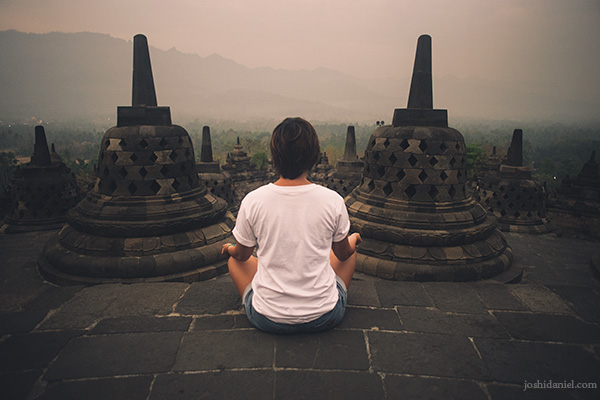 Gemala Hanafiah sitting in a meditative pose in Borobudur, Indonesia