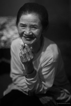 Black and white portrait of Marsiti holding a cigarette in her hand in Probolinggo, Java East, Indonesia