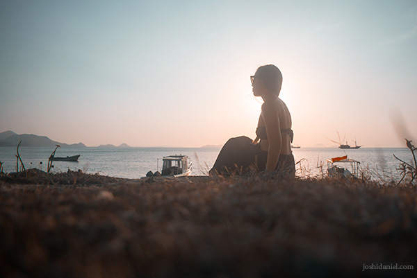 Nicole Fung watching the sun set in Labuan Bajo, Indonesia