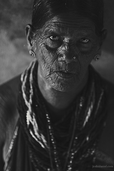 Black and white portrait of a Halakki tribe woman wearing traditional jewellery in Kumta, Karnataka