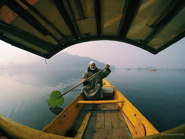 Portrait of an old man rowing a shikara in Dal Lake, Srinagar
