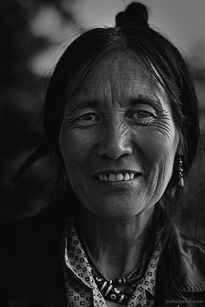 Black and white portrait of a street vendor lady in McLeod Ganj, Dharamsala