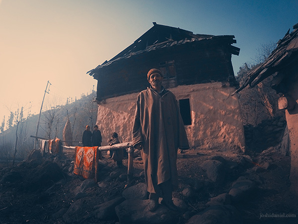 Portrait of a Kashmiri man standing in front of his house in Anantnag, Jammu and Kashmir