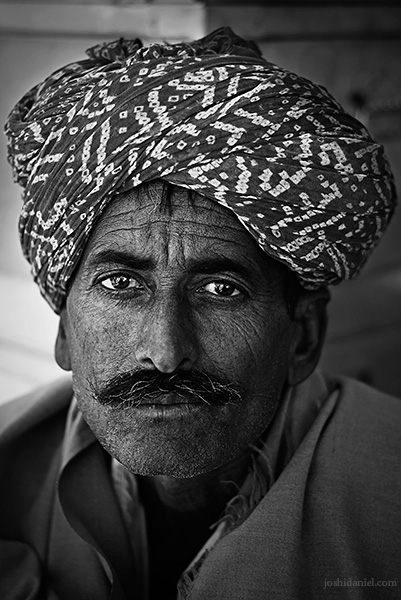 Black and white portrait of a turban-wearing Rajasthani man in Jaisalmer