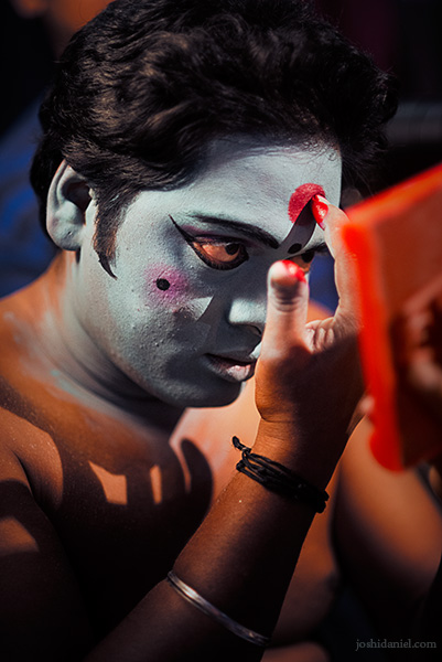 Portrait of a man doing his makeup for kattai koothu