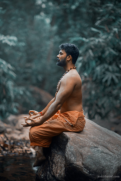 Vivek Gopan sitting and meditating in Kallar, Trivandrum