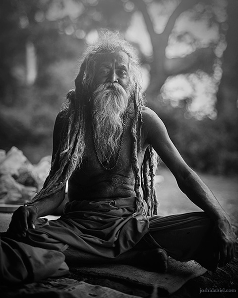 Black and white portrait of a sadhu at the Kumbh Mela in Trimbakeshwar